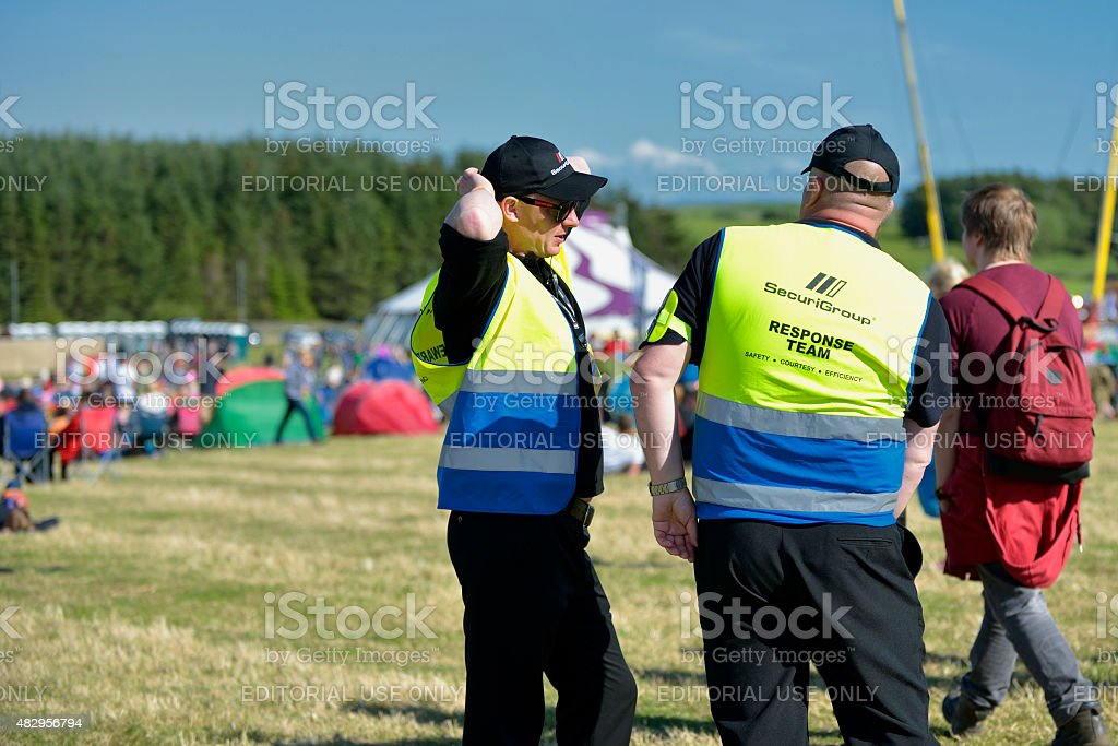 Festival security and festival goers stock photo