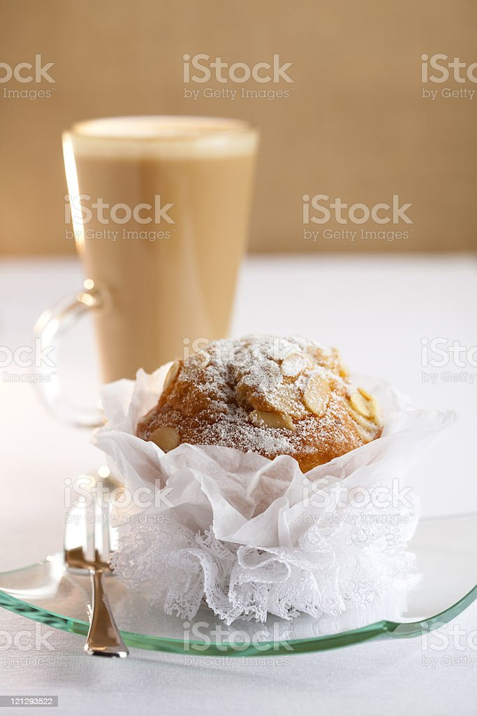 festive almond muffin and coffee latte on background royalty-free stock photo