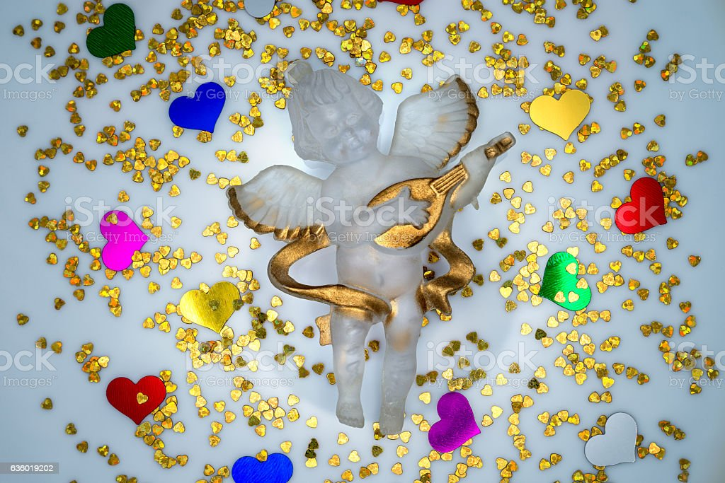 Festive angel surrounded by colorful hearts stock photo