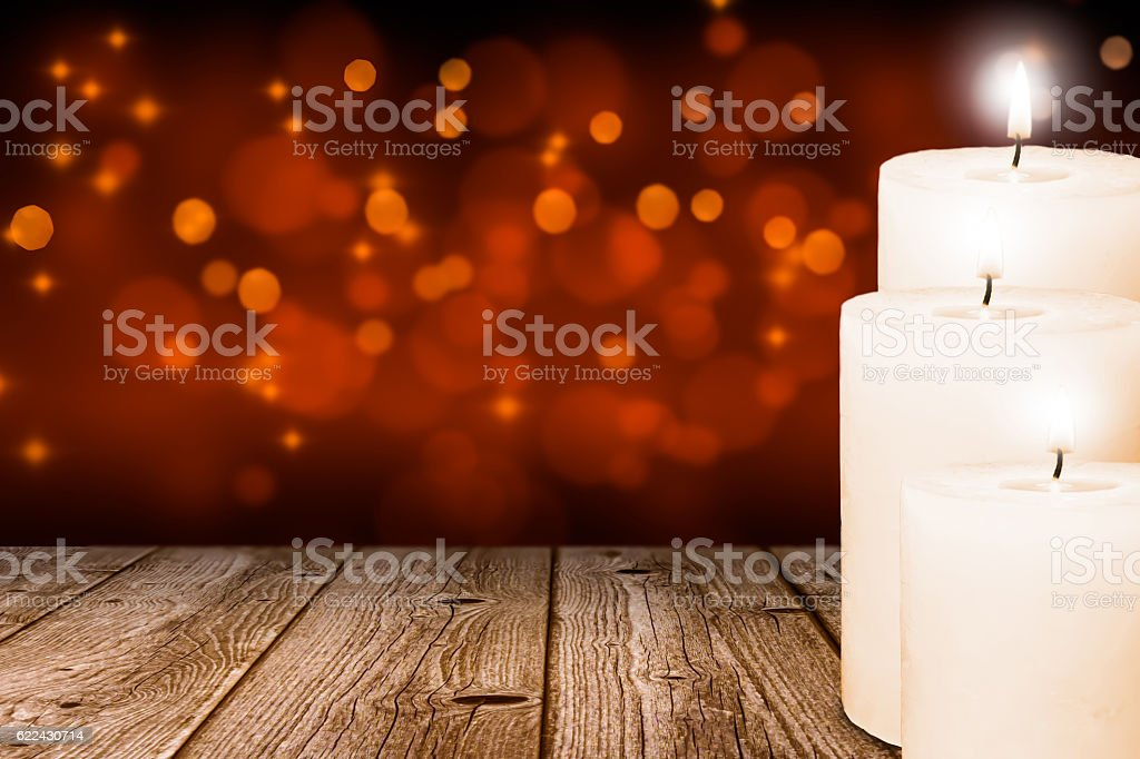 festive background with three candle lights stock photo