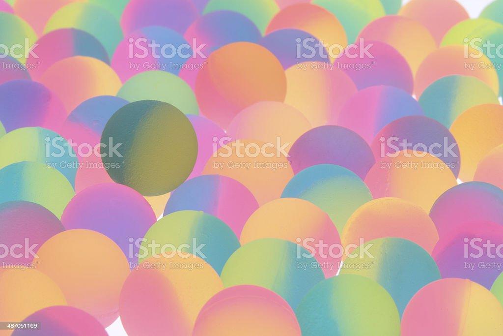 Festive bicolor plastic balls background stock photo