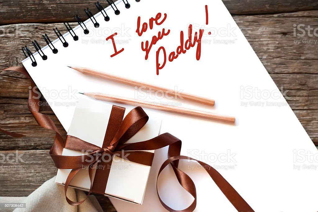 Festive Box Brown Ribbon Congratulation with Fathers Day stock photo