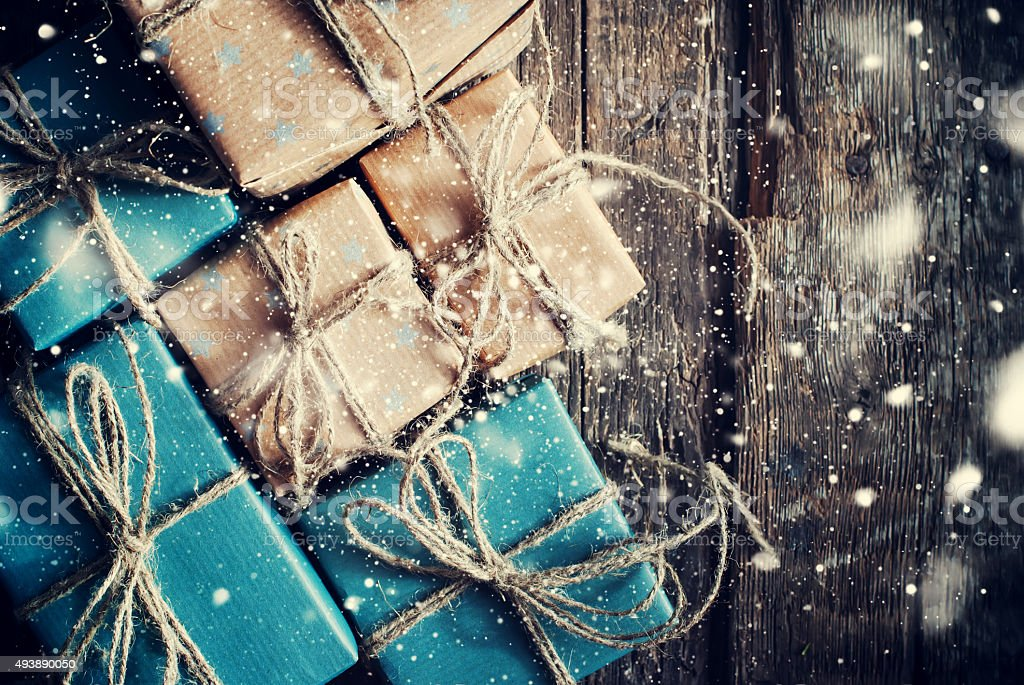 Festive Boxes with Linen Cord. Drawn Snowfall stock photo