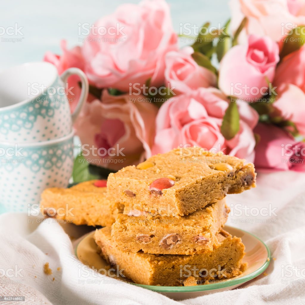 Festive breakfast flowers peanut butter bownies on pastel stock photo