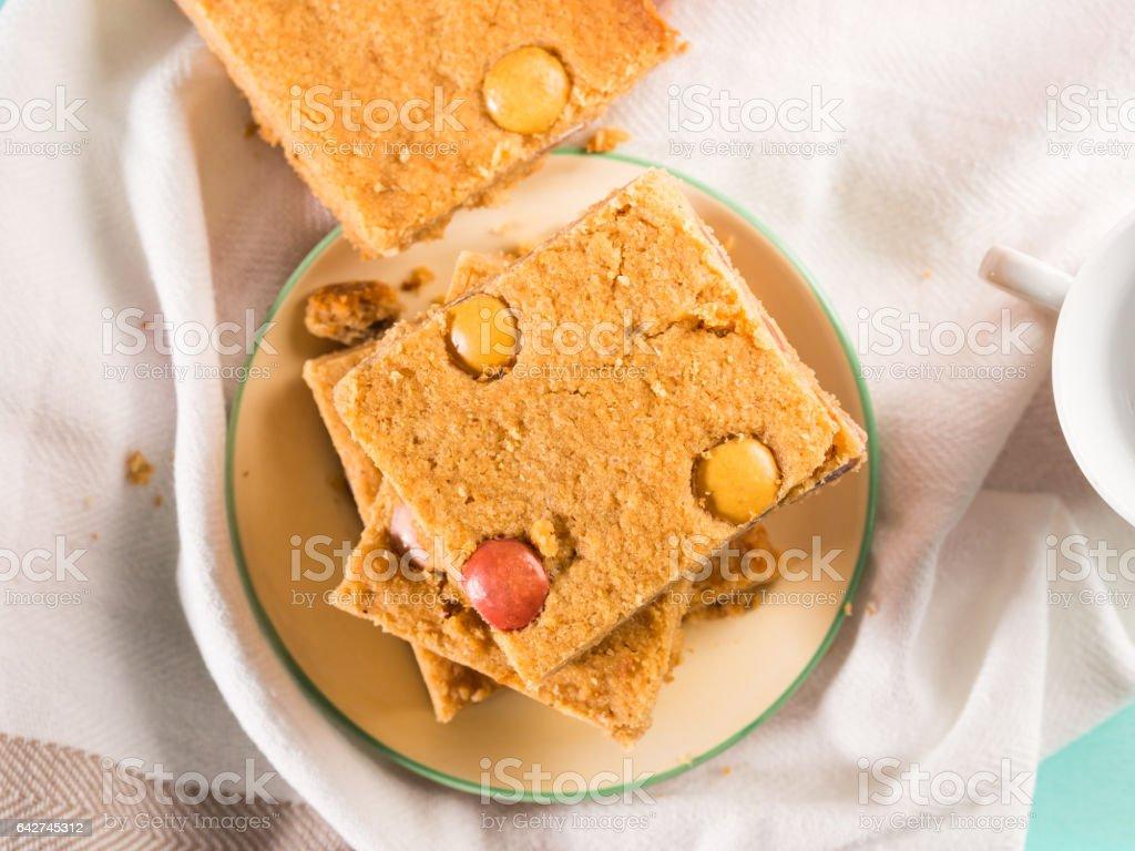 Festive breakfast flowers peanut butter bownies. Top view stock photo