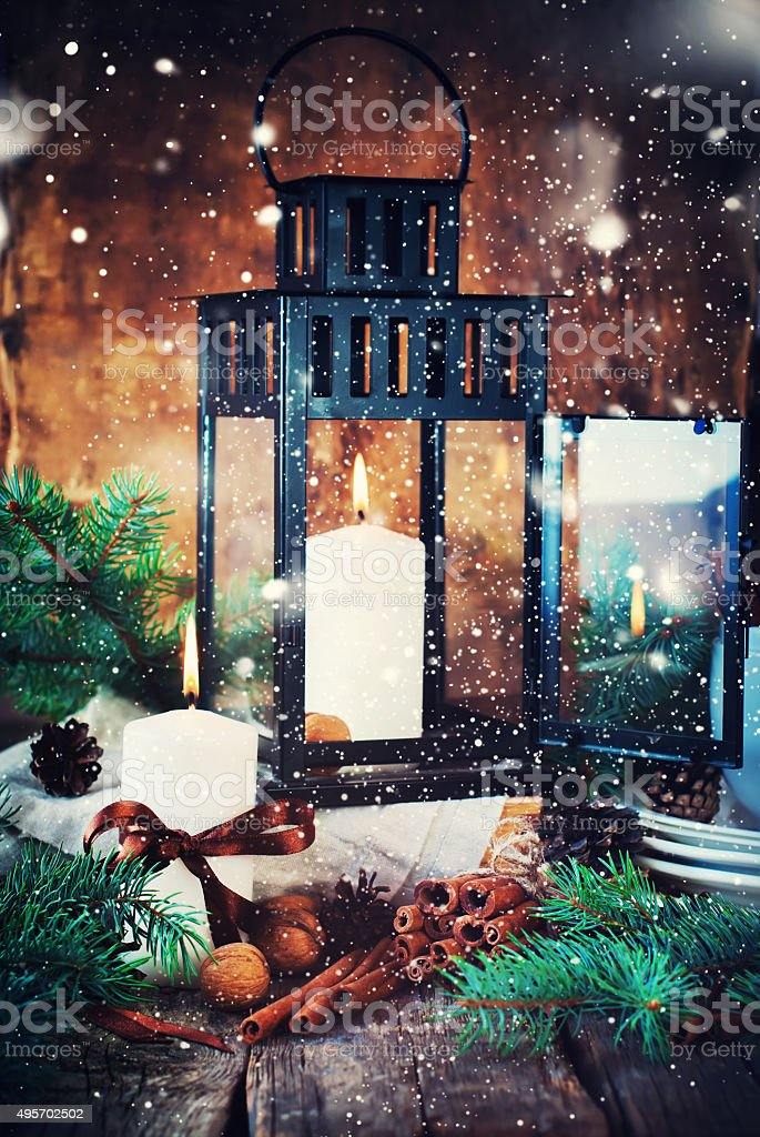 Festive Candles, Cinnamons, Pine cones in Christmas Composition stock photo