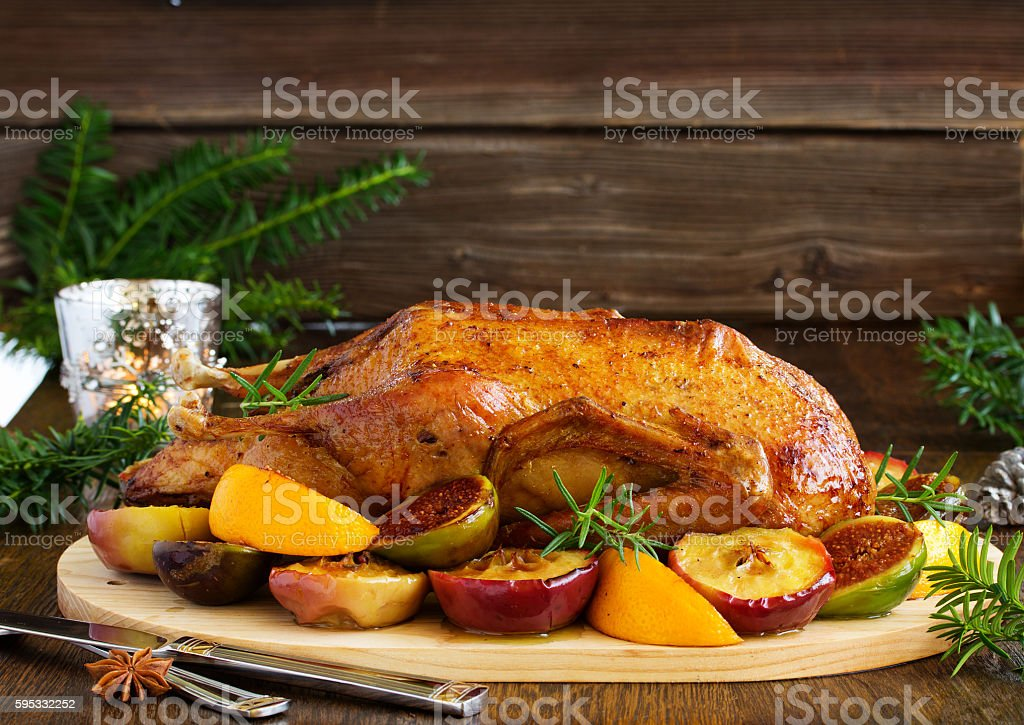 Festive Christmas duck baked with apples and figs. stock photo