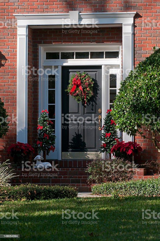 Festive Christmas wreath decorated front door stock photo