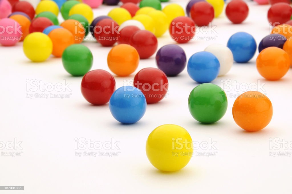 Festive, Colorful Gum Balls Candy Rolling, White Background Surface stock photo