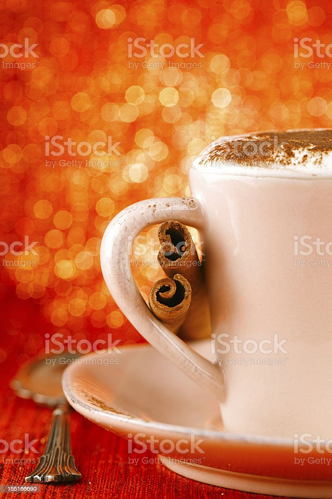 festive cup of hot  drink with cinnamon sticks royalty-free stock photo