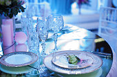 festive decorated table in the restaurant for Christmas in blue