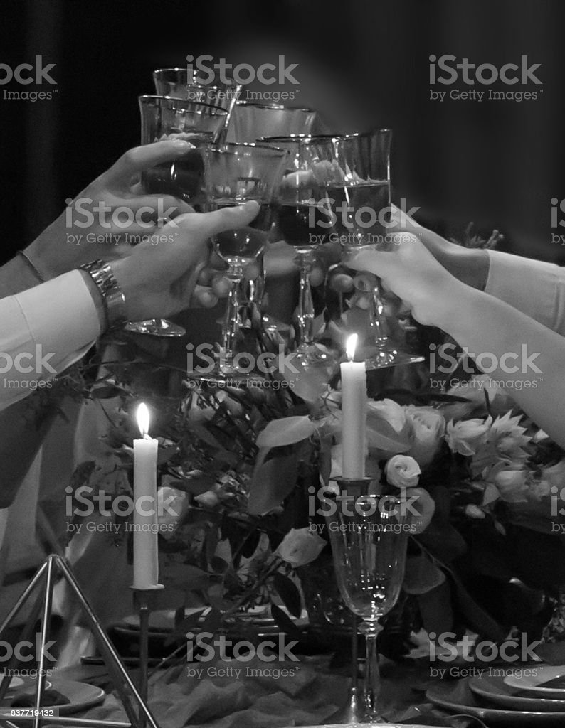 Festive feast. In the hands of glasses of wine. stock photo