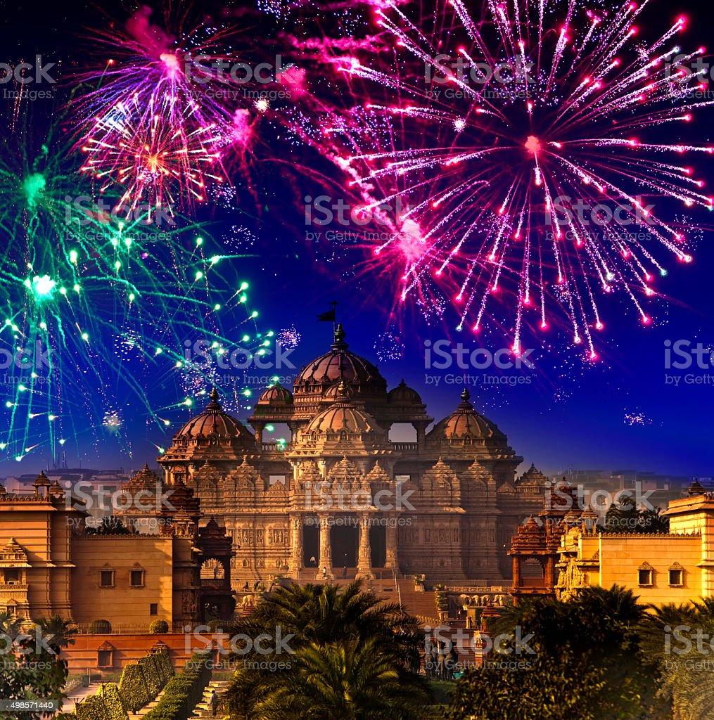 Festive firework over temple Akshardham, India. Delhi. stock photo