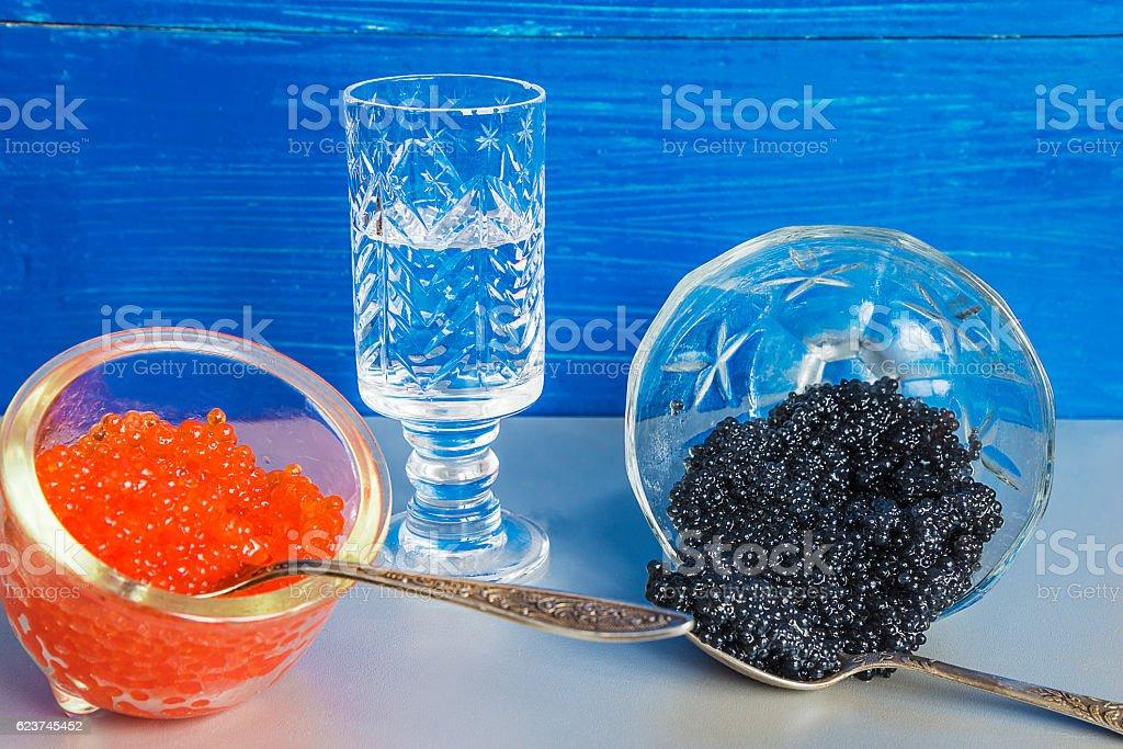 Festive food: Black caviar, salmon roe and vodka stock photo