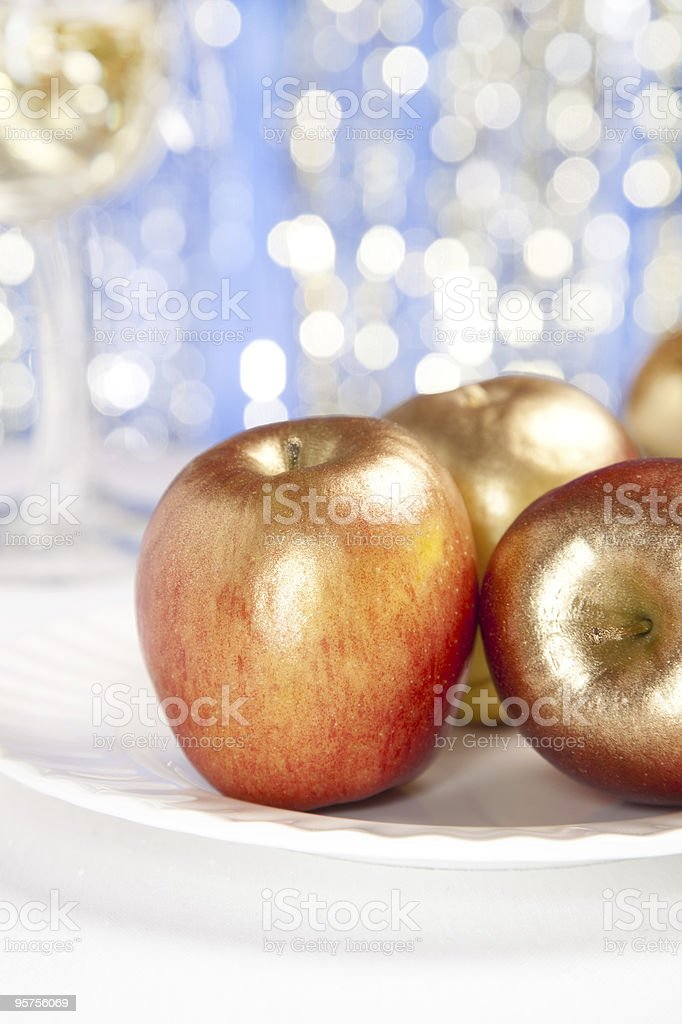 festive golden apples  on glitter red background royalty-free stock photo