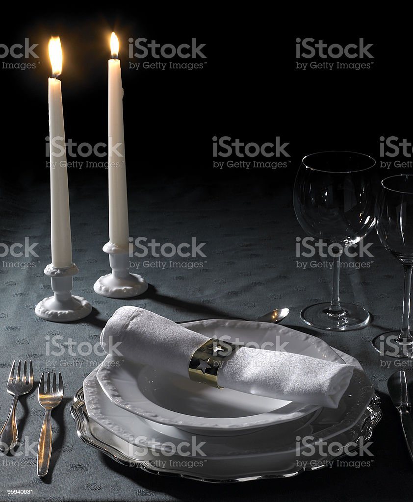 festive place setting and candlelight royalty-free stock photo