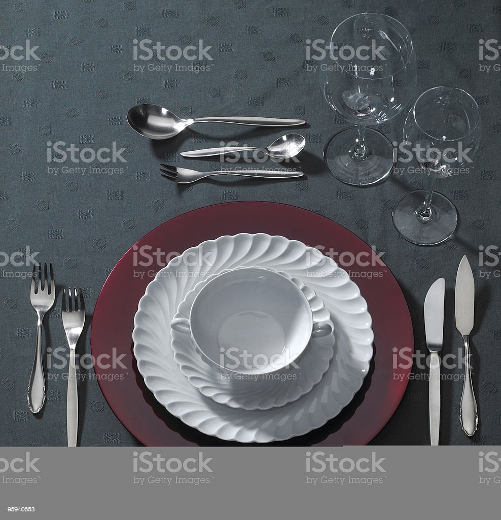 festive place setting and candlelight stock photo