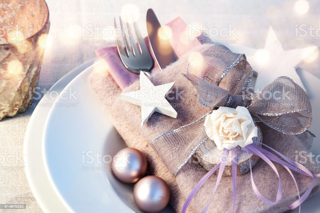 Festive place setting for a Christmas dinner stock photo