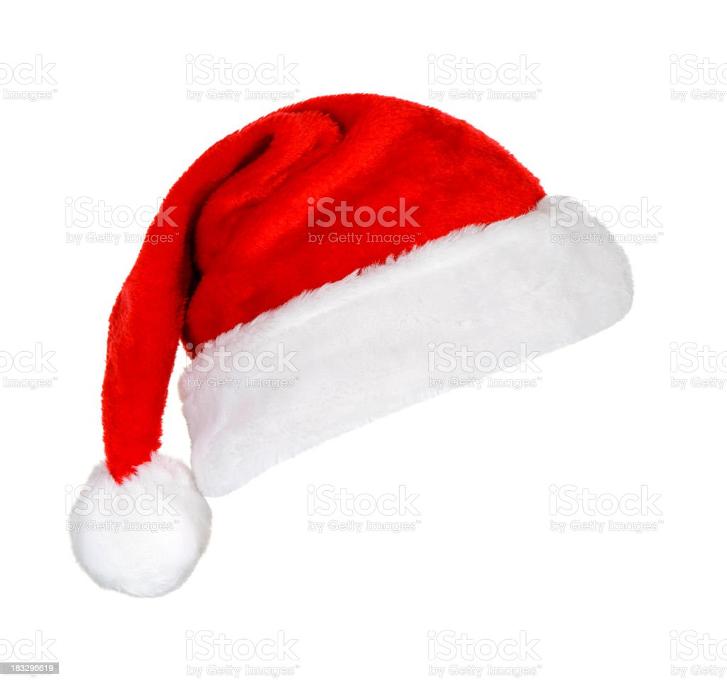 A festive red and white Santa hat on a white background stock photo