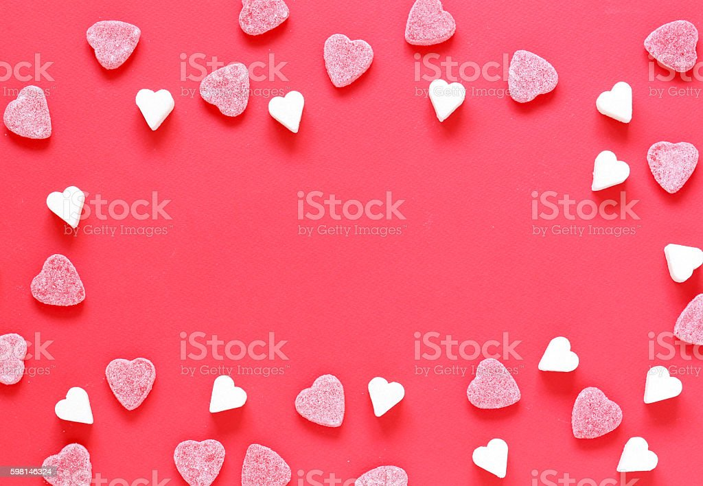 Festive red background and sweet sugar hearts, valentines day stock photo