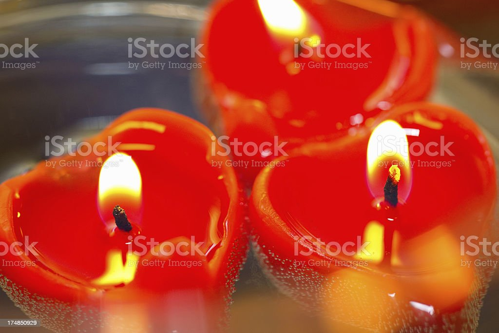 festive red candles in the shape of a heart royalty-free stock photo