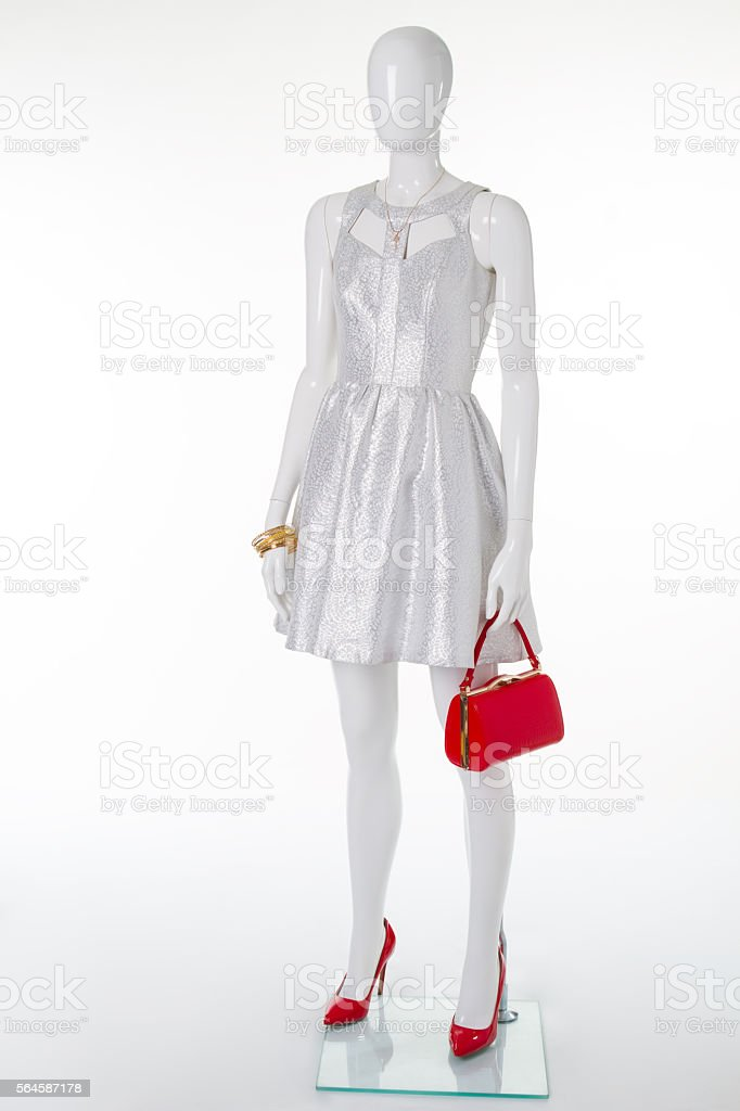Festive silver dress on a white mannequin. stock photo