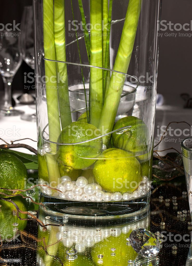 Festive table decoration with limes royalty-free stock photo