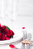 Festive table setting with beige roses