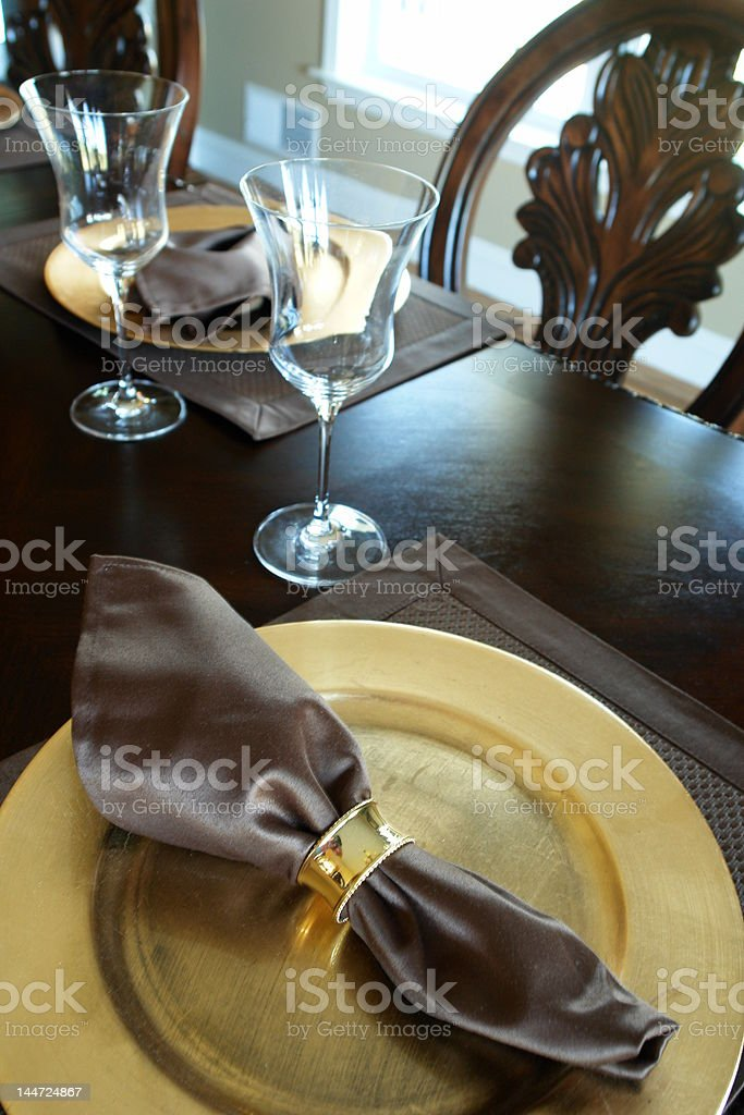 festive table setting with gold plate royalty-free stock photo