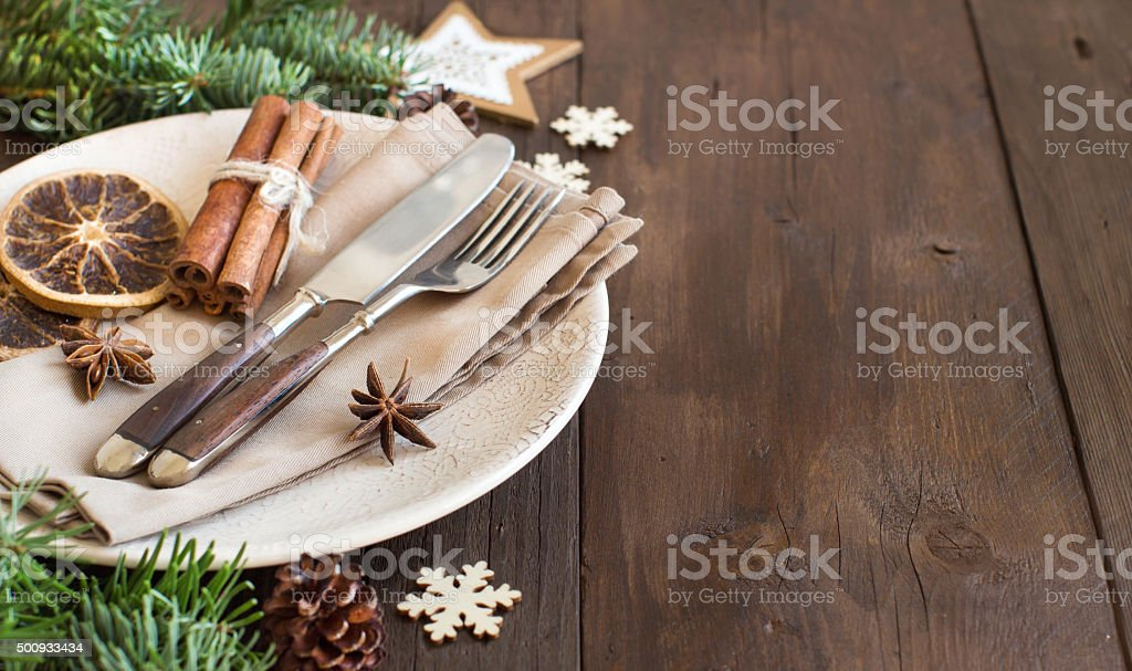 Festive table setting with spices and dried fruits stock photo