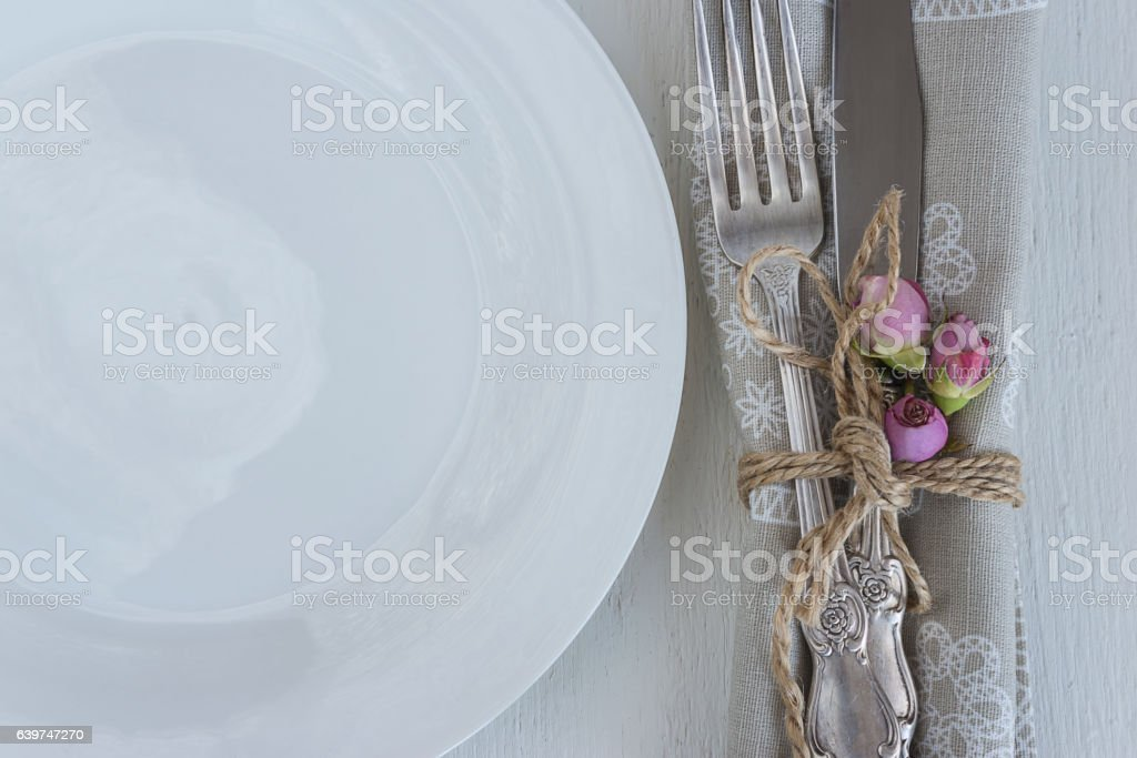 festive table setting with white plate and cutlery stock photo