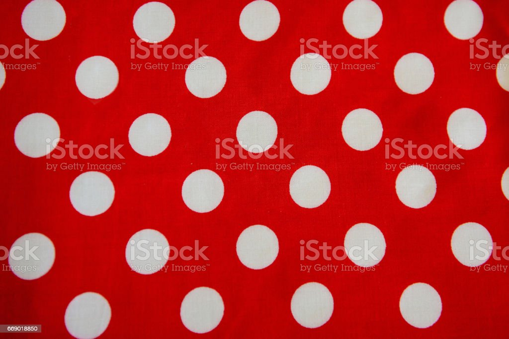 Festive tablecloth. The background is red with polka dots. stock photo