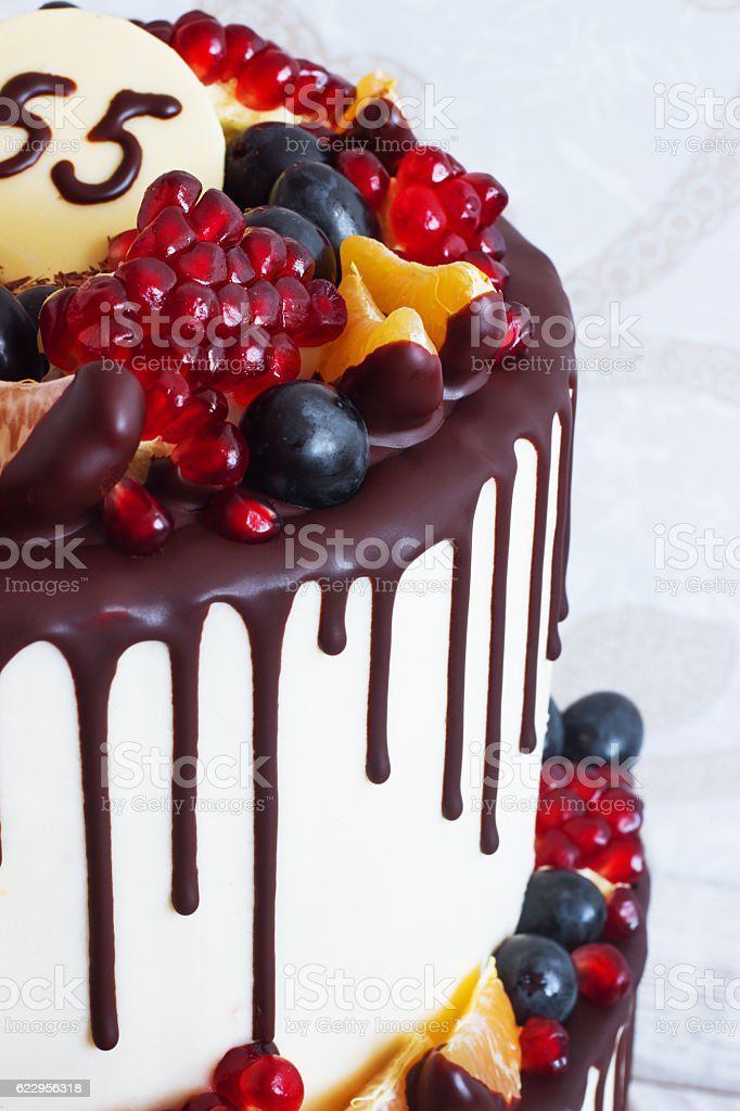 Festive two-tier cake with fruit streaks of chocolate stock photo