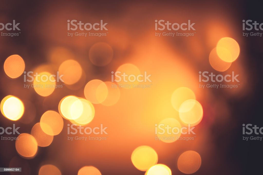 Festive warm bokeh with sparkling Christmas lights in orange colors stock photo
