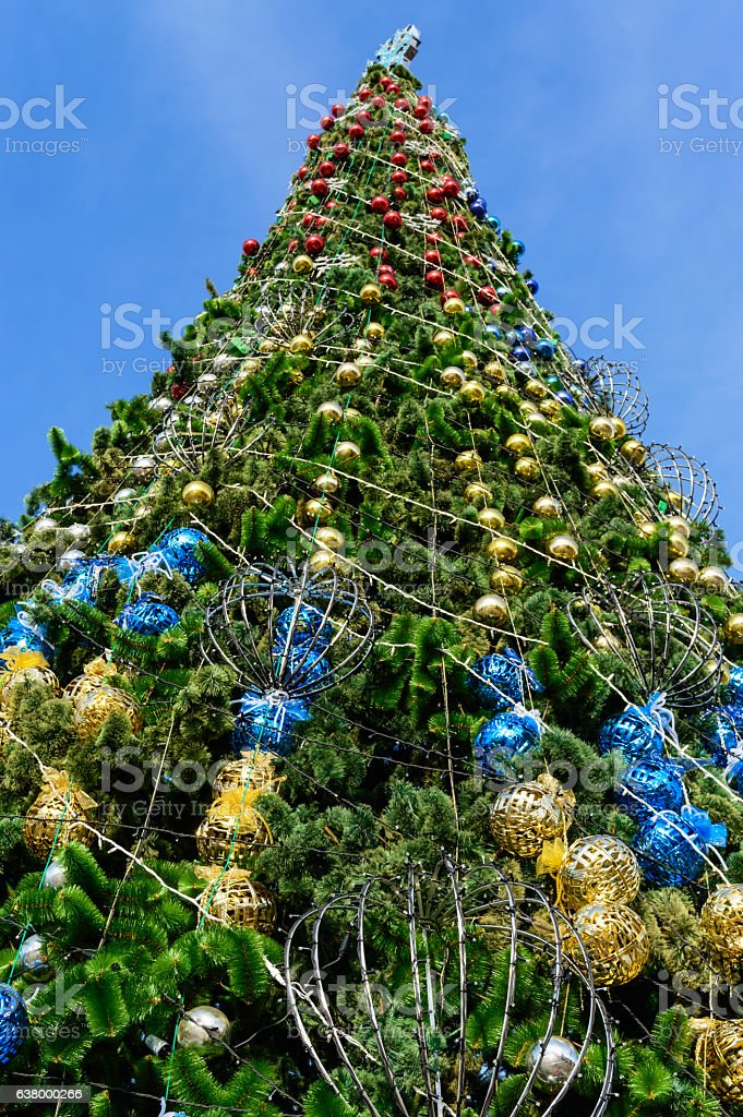 Festively decorated Christmas tree, standing on the street. stock photo