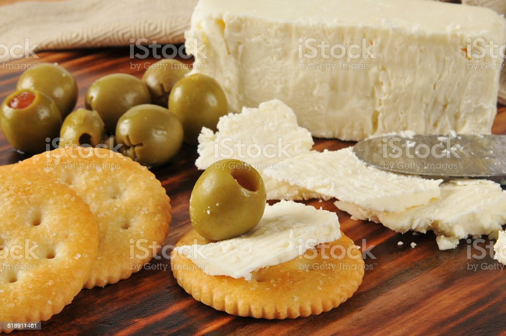 Feta cheese and green olives stock photo