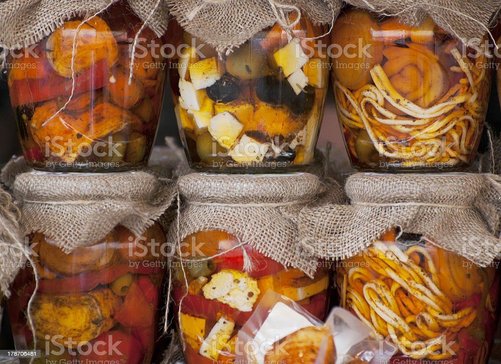 Feta cheese and olives in a jar stock photo