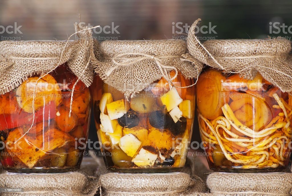 Feta cheese and olives in a jars stock photo