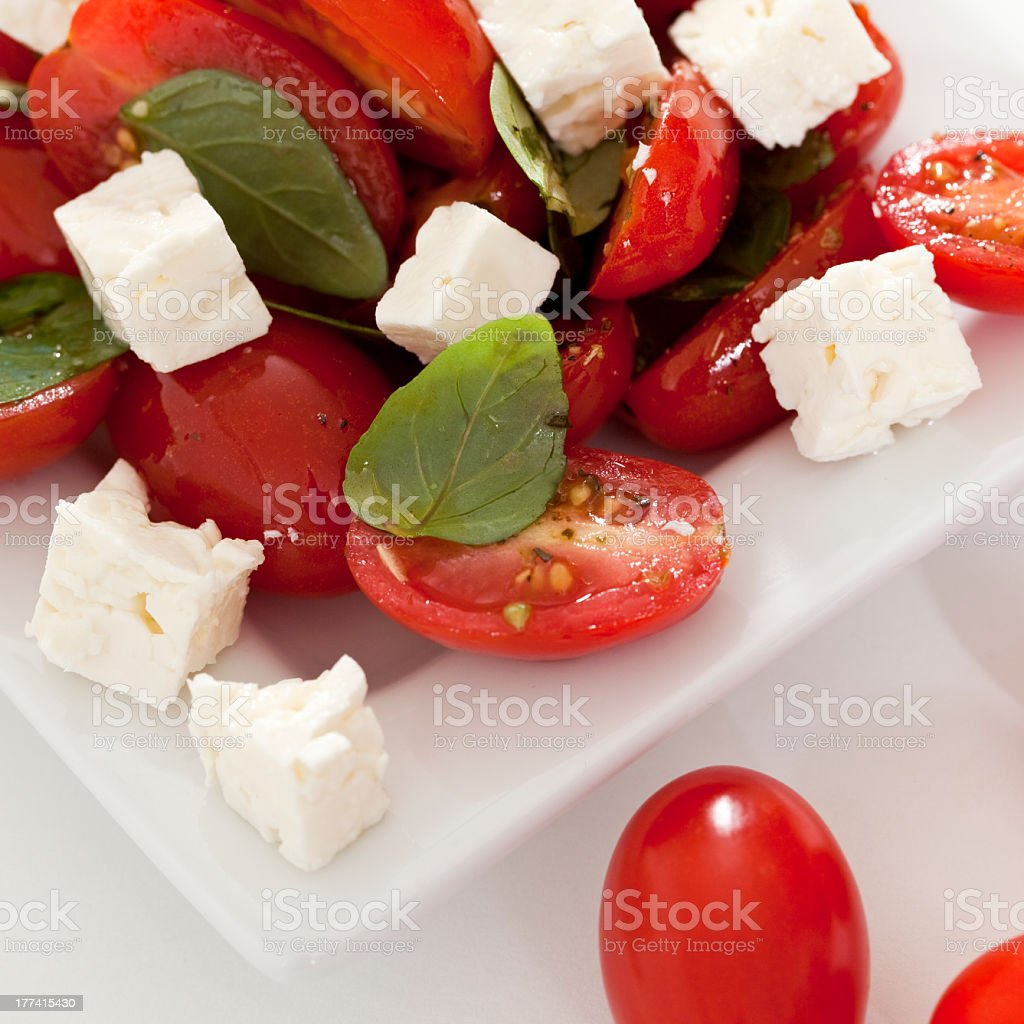 Feta Cheese and Tomato Salad in a White Plate royalty-free stock photo