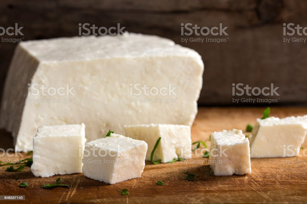 Feta cheese cubes and herbs stock photo