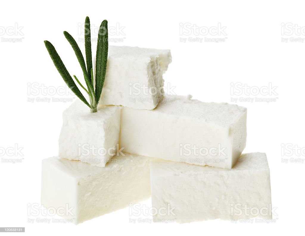 Feta cheese cubes with rosemary twig stock photo