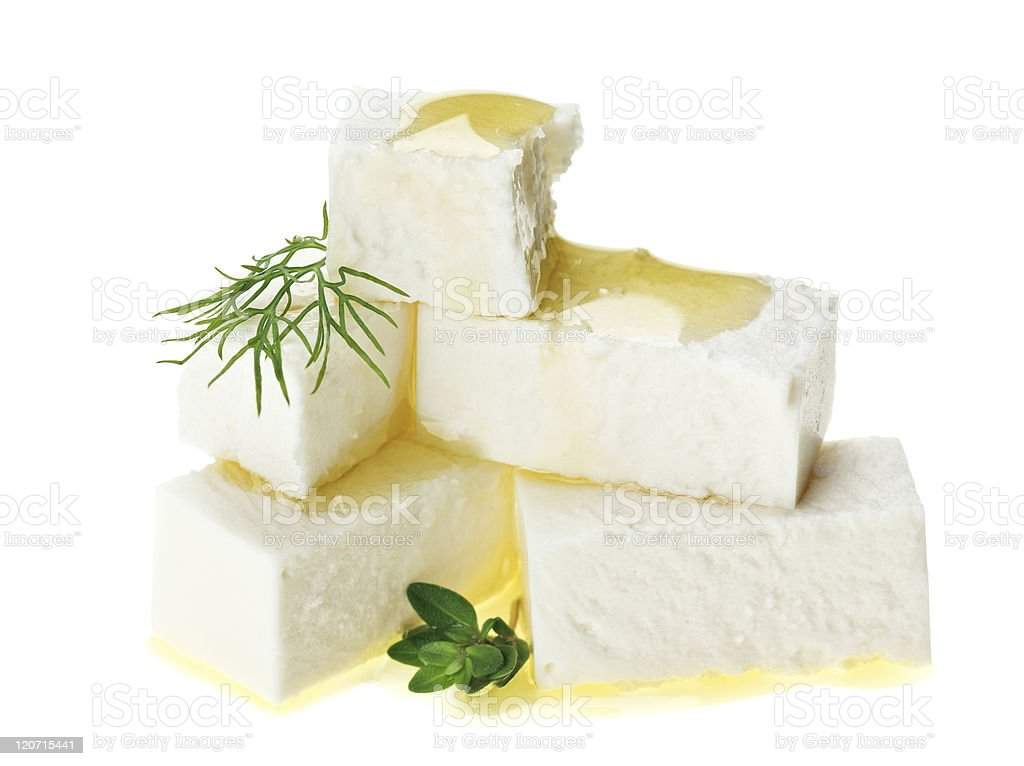 Feta cheese cubes with thyme twig and oil drops royalty-free stock photo
