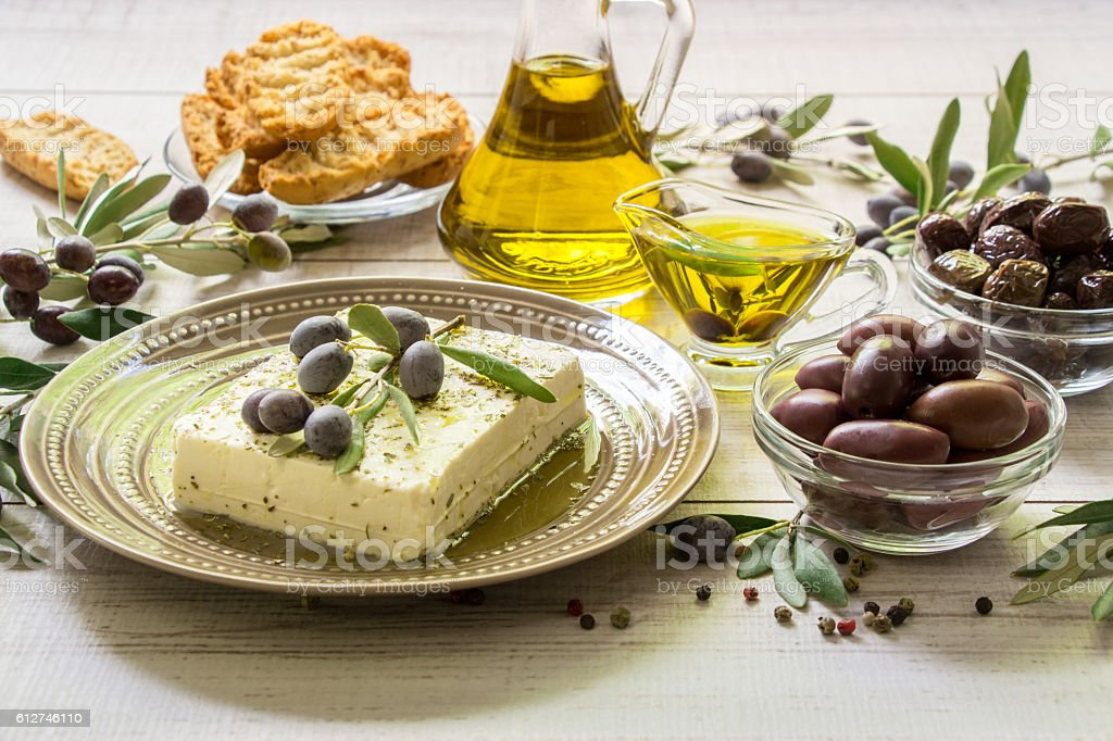 Feta cheese, olives and olive branches. stock photo