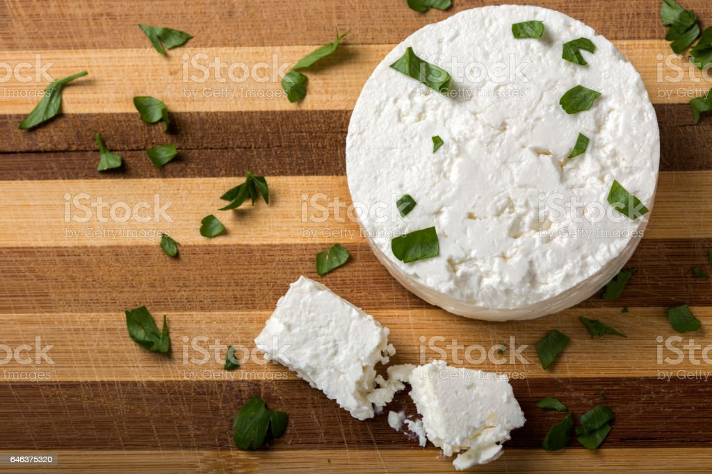 Feta cheese on wooden board stock photo