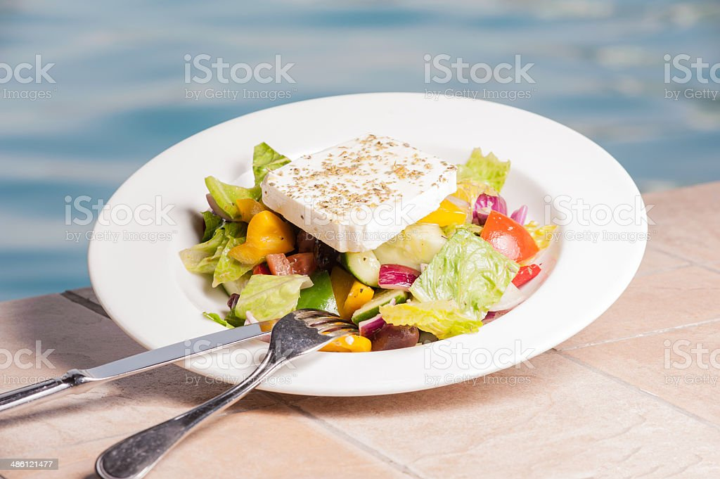 Feta Cheese salad with knife and fork stock photo