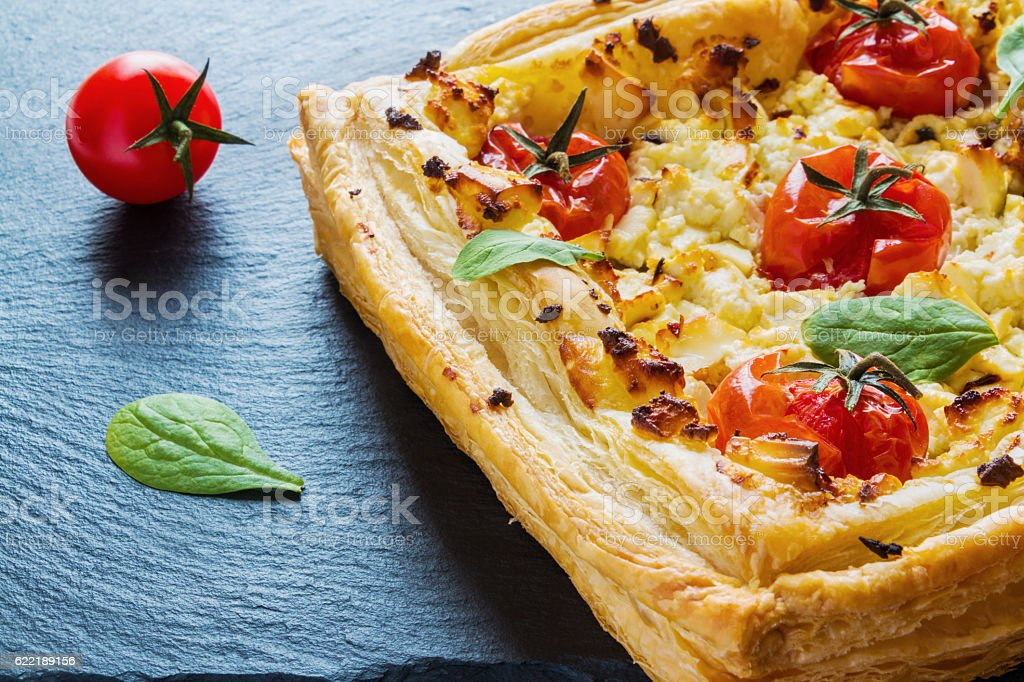 Feta cheese tart made with cherry tomatoes stock photo