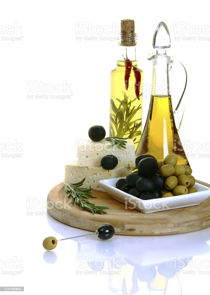 Feta, olives and olive oil with rosemary. royalty-free stock photo