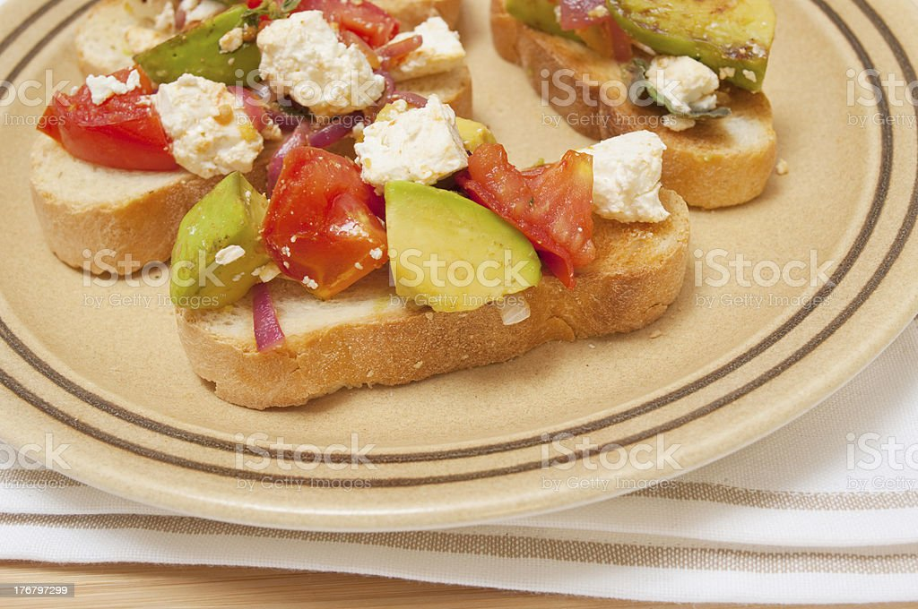 Fetta cheese, avocado and tomato on toast stock photo