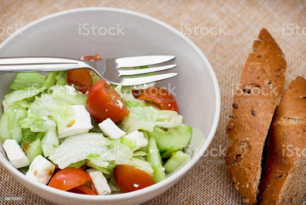 Fetta salad portion and slices of whole wheat bread stock photo