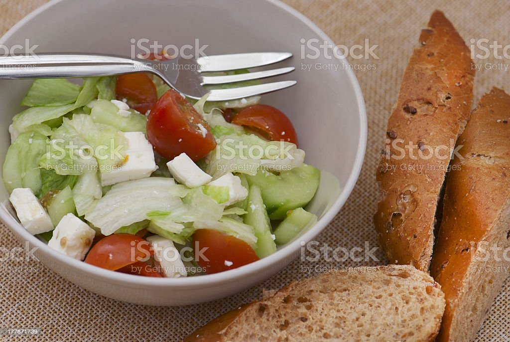 Fetta salad with slices of bread stock photo